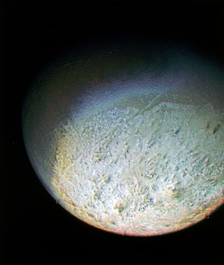 While living on Neptune's moon Triton, you'd be subjected to the coldest temperatures in the solar system, incredibly weak gravity and retrograde sunrises and sunsets. This image of Triton was taken by NASA's Voyager 2 spacecraft in 1989.
