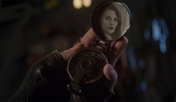 Cap's compass with a picture of Peggy