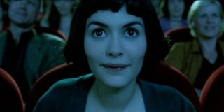 Amelie Audrey Tautou bathed in the glow of a movie screen
