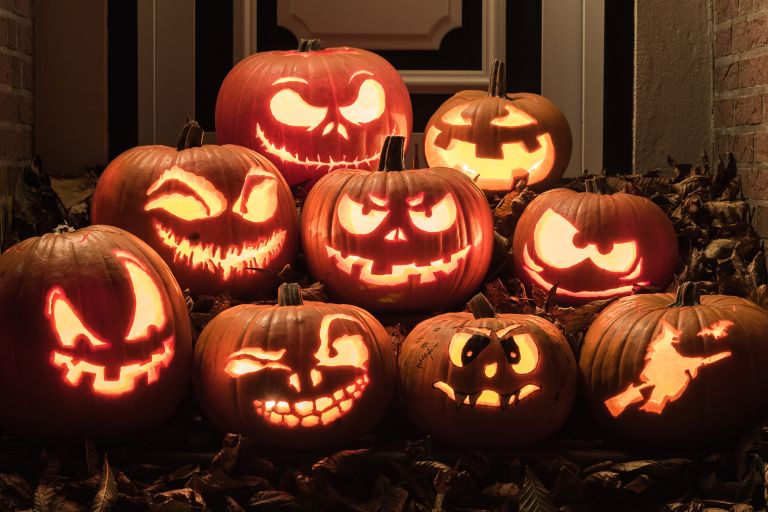 A pile of carved glowing pumpkins
