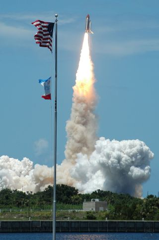Space shuttle Discovery lifts off on mission STS-121