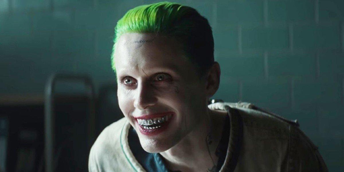 The Joker (Jared Leto) smiles in Arkham Asylum in Suicide Squad (2016)