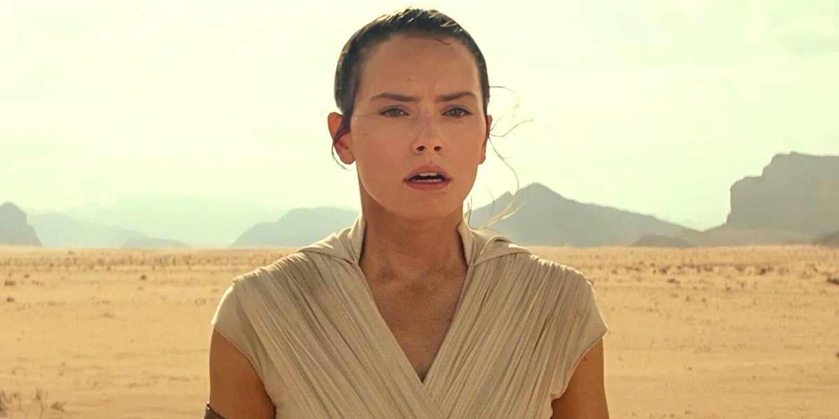 Daisy Ridley looks into distance as Rey in desert background Star Wars: The Rise of Skywalker