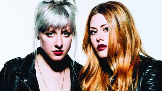 Rebecca and Megan Lovell of Larkin Poe wearing leather jackets and looking at the camera.