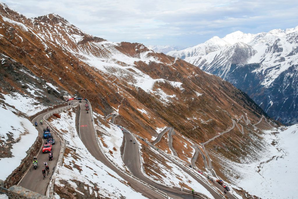 Cyclists ride uphill at the Passo dello Stelvio Stelvio Pass during the 18th stage of the Giro dItalia 2020 cycling race a 207kilometer route between Pinzolo and Laghi di Cancano on October 22 2020 Photo by Luca Bettini AFP Photo by LUCA BETTINIAFP via Getty Images