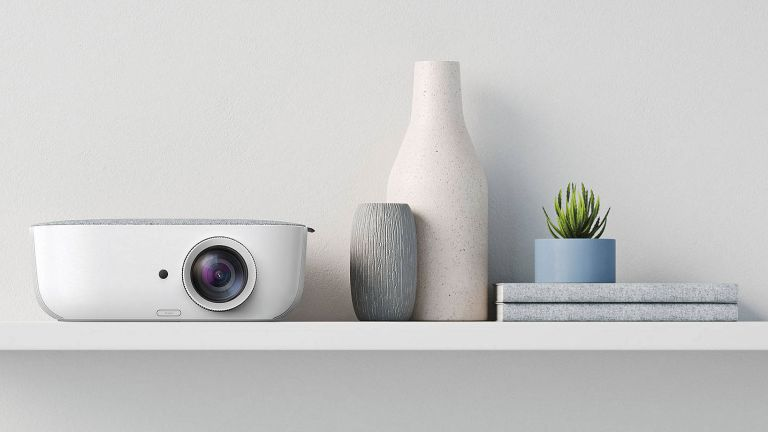 projector and vase and plant on shelf against white wall by john lewis & partners an example of the best mini projectors