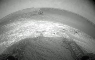 Mars Rover Dips Toe into Crater
