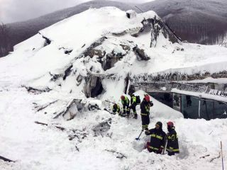 Italian firefighters search for survivors after an avalanche buried a hotel near Farindola, Italy, Thursday, Jan. 19, 2017.