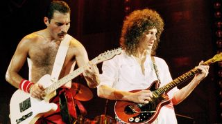 Photo of QUEEN, Freddie Mercury and Brian May performing on stage