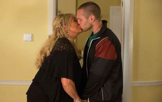 Keanu and Sharon kiss