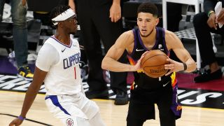 Clippers vs Suns live stream: Devin Booker #1 of the Phoenix Suns looks to pass against Reggie Jackson #1 of the LA Clippers
