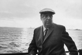 Chilean poet Pablo Neruda leans on a ship's railing during the 34th annual PEN boat ride around New York City on June 13, 1966.