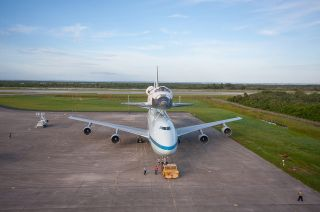 NASA's Shuttle Carrier Aircraft (SCA) is parked on the apron of the Shuttle Landing Facility at the Kennedy Space Center in Florida with space shuttle Endeavour secured on its back on Sept. 16, 2012.