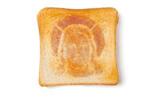 Art showing image of Jesus on toast