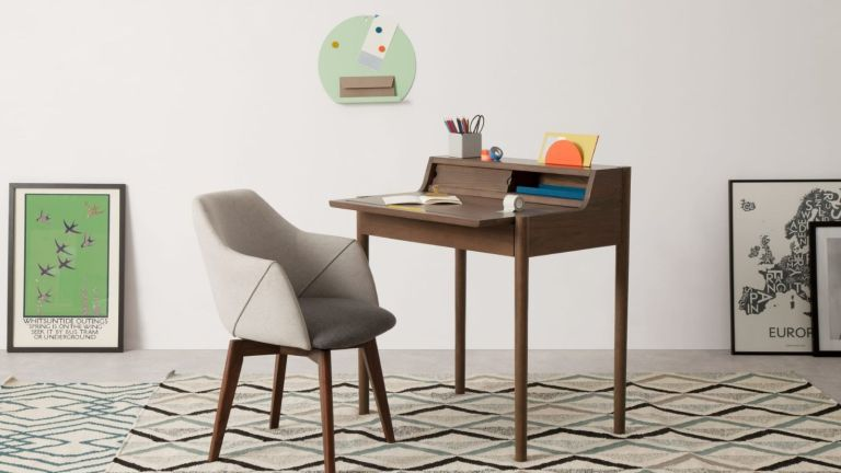 MADE Leonie wooden desk on geometric rug with grey fabric chair, wall art and grey walls