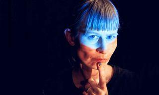Jenny Hval against a black background