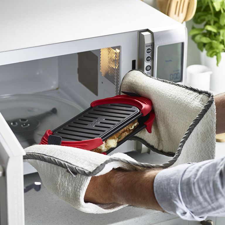Lékué Microwave Grill for Toasted Sandwiches and More: lifestyle image of the machine being placed inside a microwave