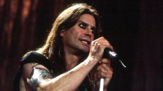 A photograph of Ozzy Osbourne on stage at Ozzfest in the 90s