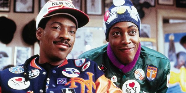 Eddie Murphy and Arsenio Hall decked out in new York stuff in Coming To America