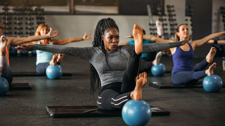 women doing Pilates best workouts in gym