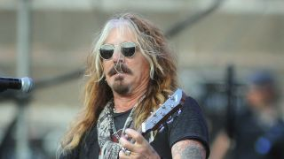 A picture of John Corabi on stage with The Dead Daisies