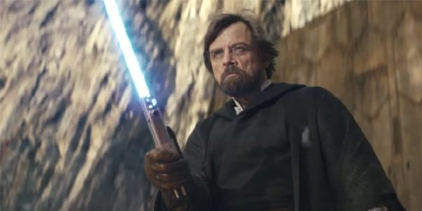 Luke with his lightsaber in Star Wars The Last Jedi