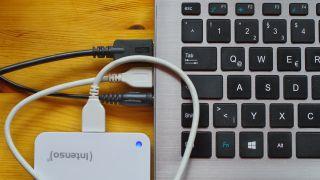 close up of external hard drive and laptop