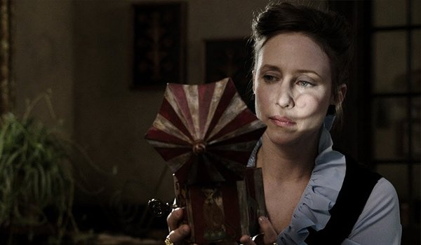 The Conjuring Vera Farmiga holding toy
