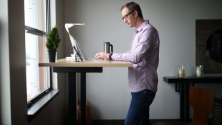 Man Working at a Standing Desk