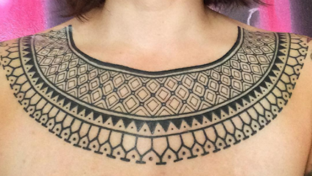 Tribal collar tattoo