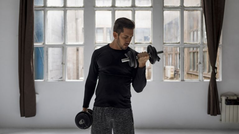 Man doing a dumbbell bicep curl