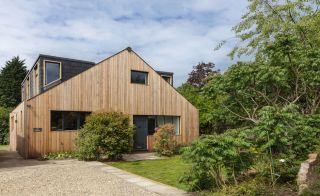 Siberian larch and slate tile cladding on renovated bungalow