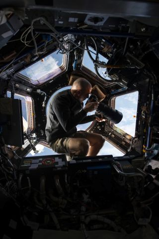 Chris Cassidy floats in the ISS cupola
