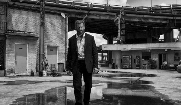 Logan Hugh Jackman strides defiantly in black and white