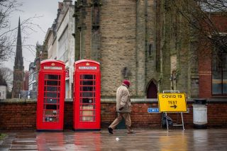 A man walks past a Covid-19 testing center in Southport, United Kingdom, on Feb. 2, 2021.