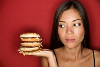 A woman hungrily eyes a giant burger