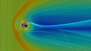 The giant magnetic field surrounding Earth changes shape due to the planet's north and south magnetic poles as well as the solar wind (the steady stream of particles coming from the sun).