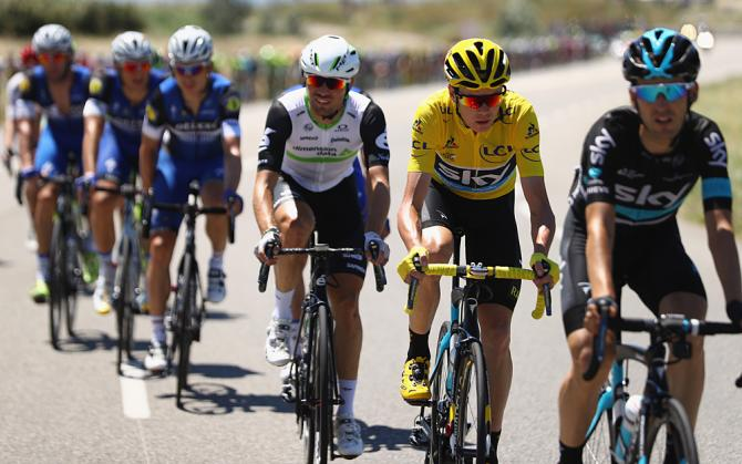 Mark Cavendish (Dimension Data) sits behind yellow jersey Chris Froome (Team Sky)