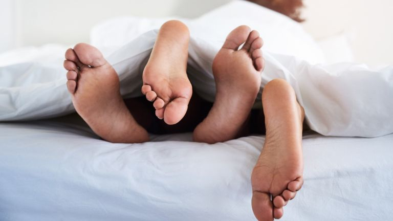 how to have good sex, couple's feet poking out from under sheets