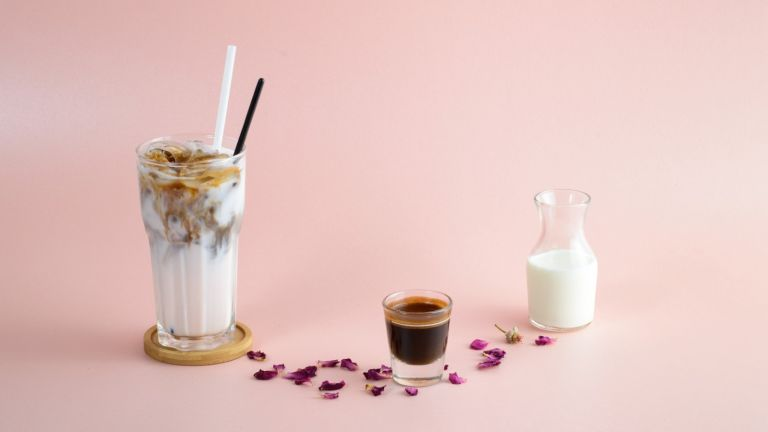 A glass of Iced coffee with milk and syrup - stock photo