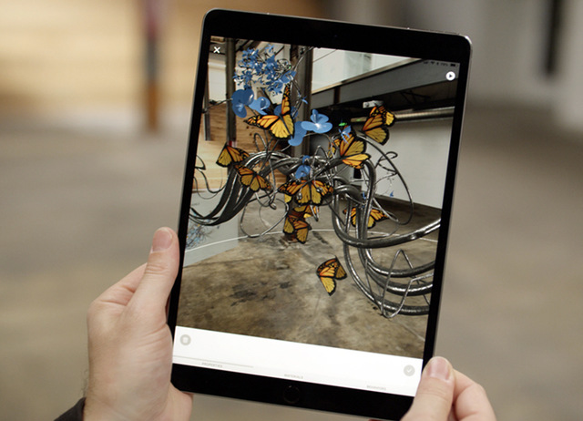 ipad with image of creature on it