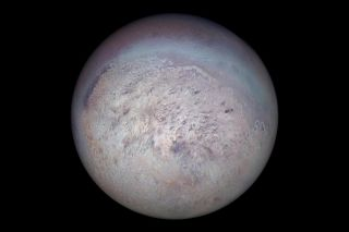 NASA's Voyager 2 spacecraft captured dark streaks produced by geysers visible on the icy surface of Triton's south polar region.