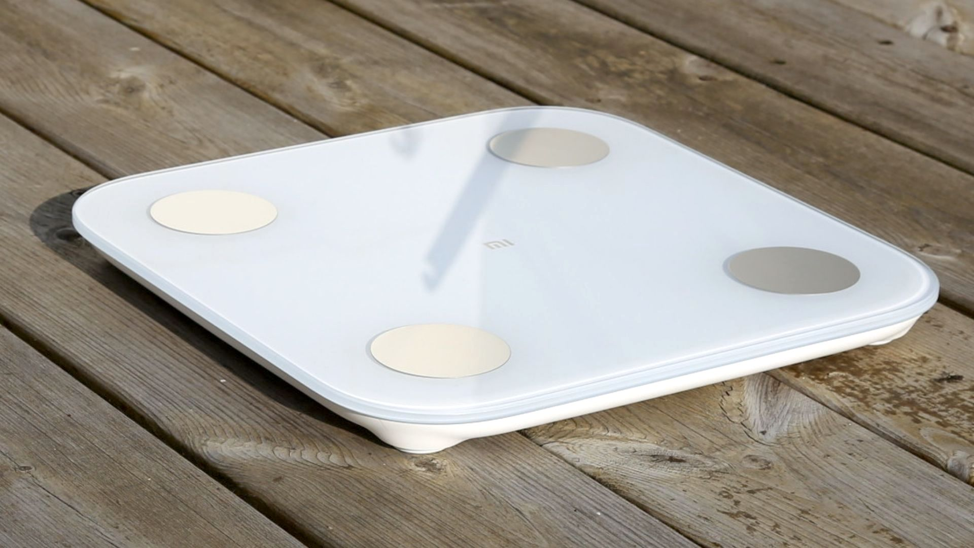 Xiaomi Mi Body Composition Scale 2 on a wooden floor