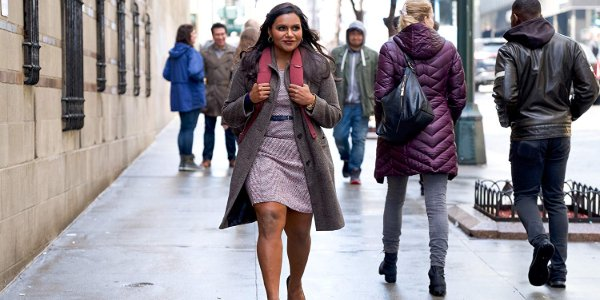 Late Night Mindy Kaling walking on the streets of New York with a smile