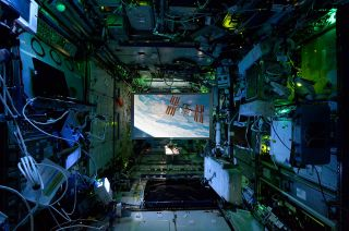 This composite image shows the Screen Innovations' ISS Viewscreen deployed onboard the space station.