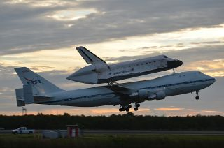 Space shuttle Endeavour, atop its Shuttle Carrier Aircraft, takes off on NASA's last-ever ferry flight from the Kennedy Space Center in Florida on Sept. 19, 2012. Endeavour is headed for Los Angeles, Calif., to be put on public display at the California S