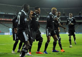 Fortune Makaringe celebrates his goal with teammates