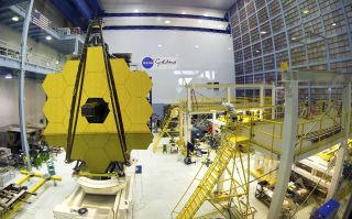 The main mirror for the James Webb Space Telescope is tested in the giant clean room at NASA's Goddard Space Flight Center.