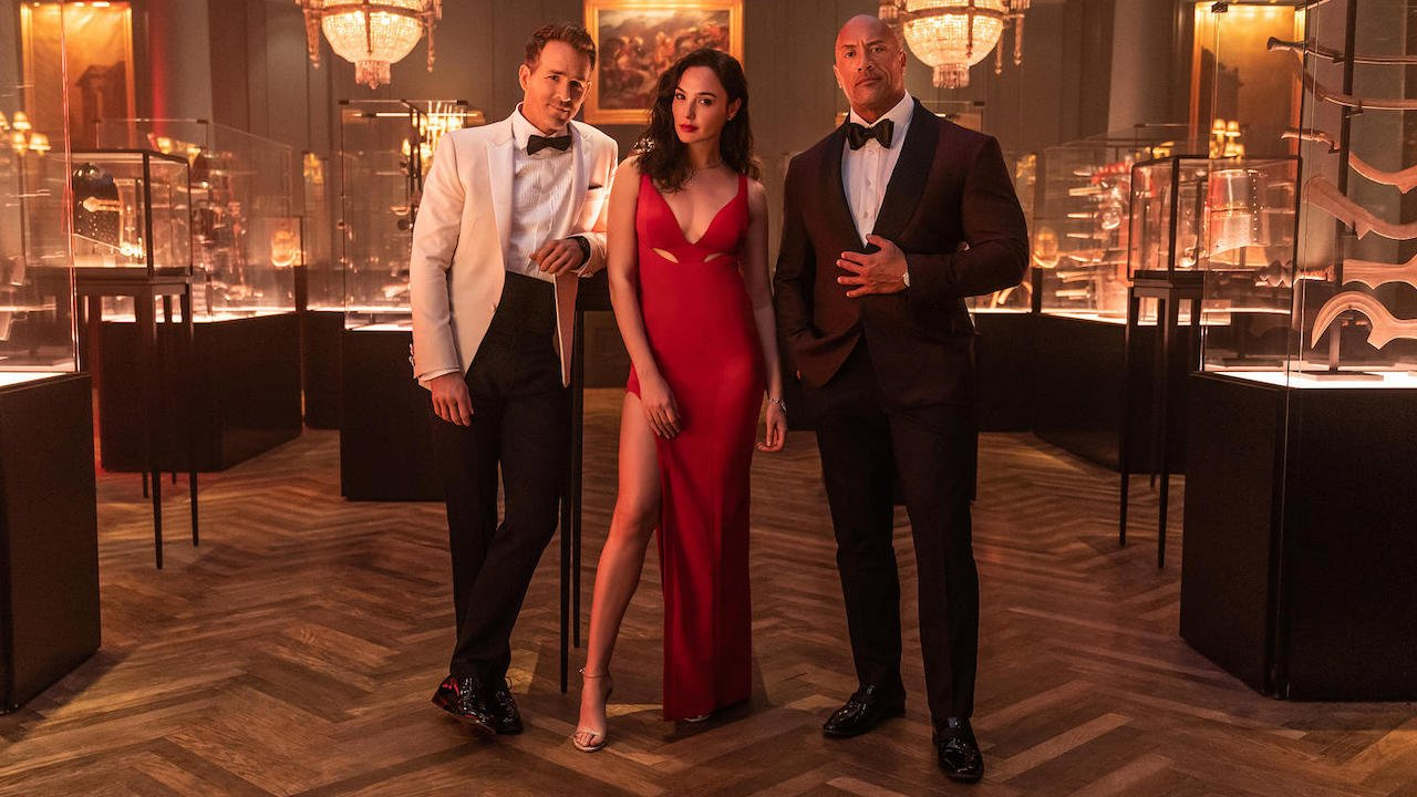 The Rock, Gal Gadot And Ryan Reynolds All Have Funny Takes On That First Red Notice Scene