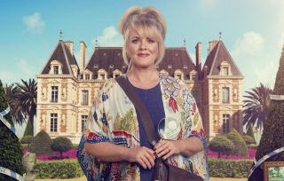 Jean White (Sally Lindsay) stands in front of a majestic chateau, holding a magnifying glass with police tape reflected in it